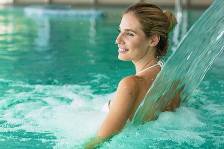 Beautiful attractive woman enjoying time in pool Stock Photo