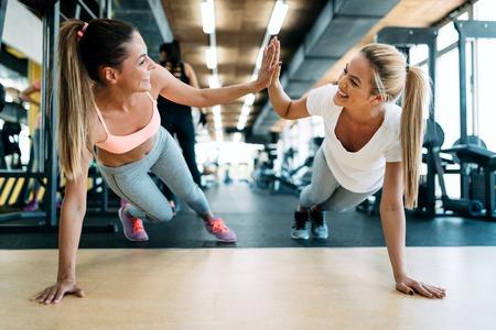 Two attractive fitness girls doing push ups Reklamní fotografie