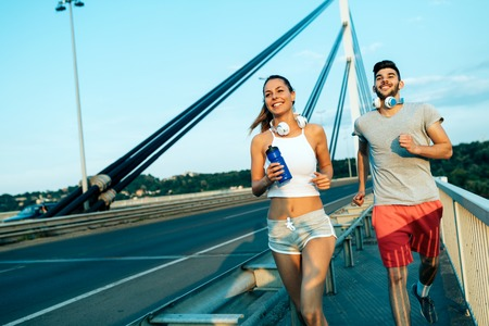 Attractive man and beautiful woman jogging together Zdjęcie Seryjne