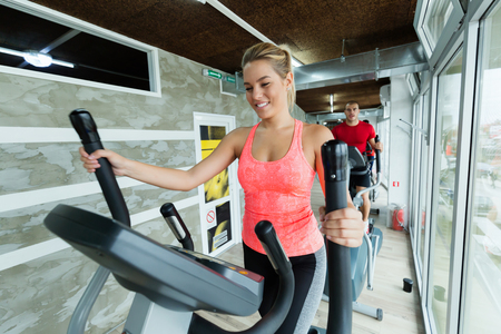 Young beautiful woman doing cardio in gym Reklamní fotografie