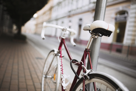 Picture of red bicycle with white seat and frame