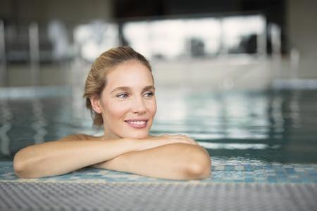 Portrait of beautiful woman relaxing in swimming pool Banco de Imagens