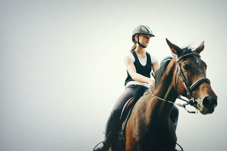 Picture of young girl riding her horse Stock Photo