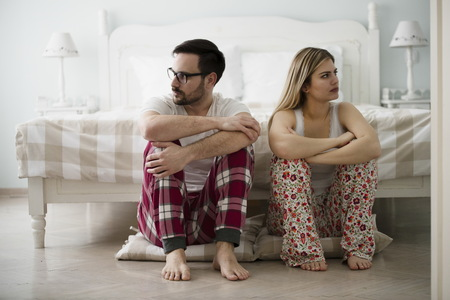 Unhappy young couple having difficulties in relationship Stock Photo