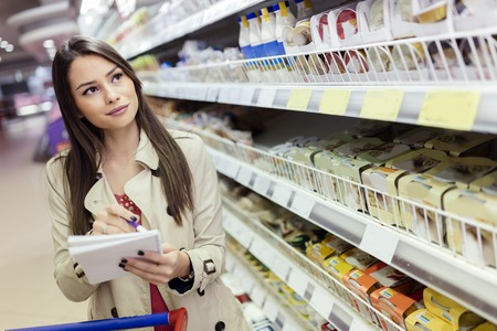Beautiful woman shopping in supermarket
