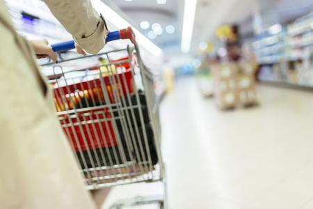 Woman pushing shopping trolley