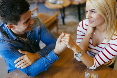 Beautiful couple in love flirting in cafe