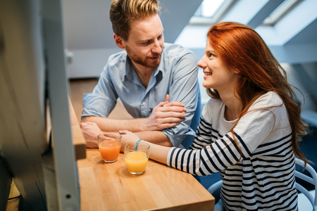 living room window: Couple in love talking smiling at home Stock Photo