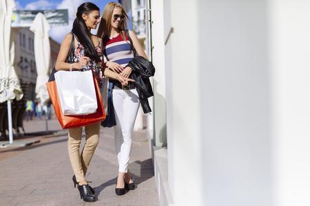Beautiful women shopping spree Stock Photo