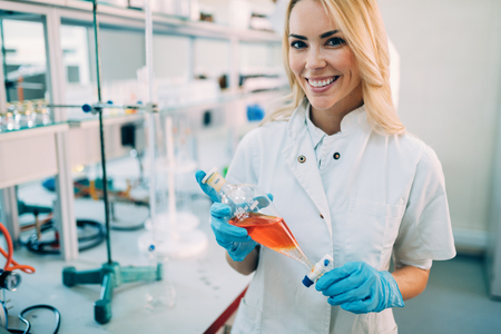 Attractive student of chemistry working in laboratory
