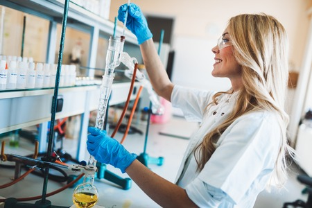 Female student of chemistry working in laboratory