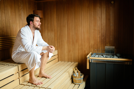 Handsome man relaxing in sauna Stok Fotoğraf - 85726138
