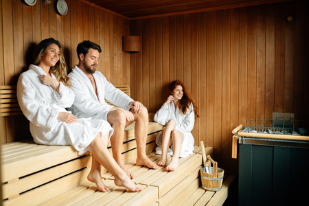 People relaxing in sauna