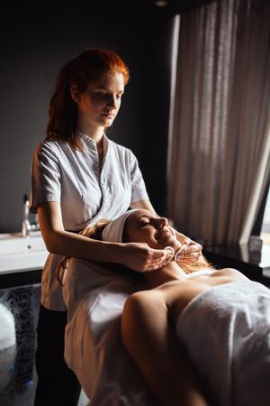 Lovely brunette enjoying massage