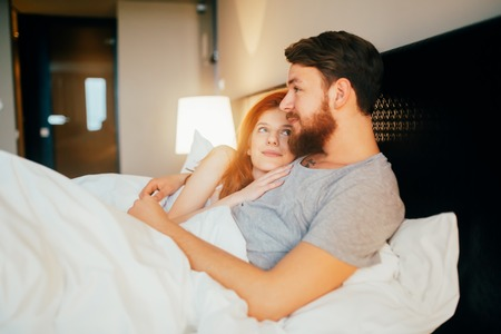 Sensual cute young couple in bed cuddling Stock fotó