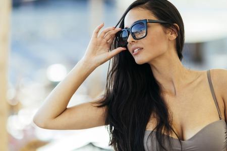 Beautiful brunette in bikini outdoor