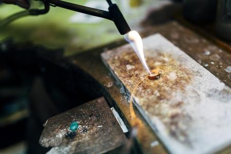 Jeweler working on ring Stock Photo