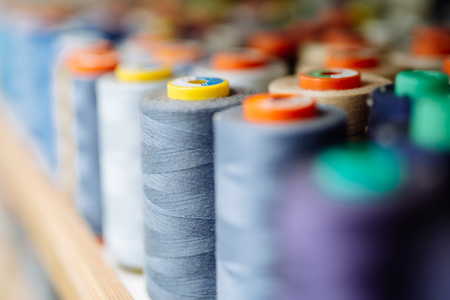 Colorful thread spools used in fabric industry 写真素材