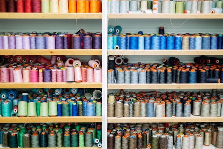 Colorful thread spools used in fabric industry Banco de Imagens