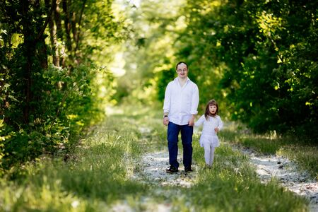People with down sydrome walking in forest Stock Photo
