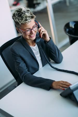 Portrait of busy female architect talking on phone Banco de Imagens