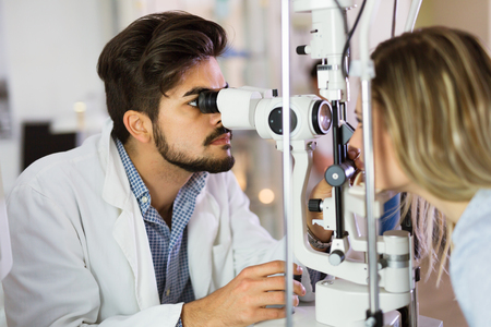 Checking eyesight in a clinic. Ophthalmology. Medicine and health concept. Stock Photo - 86634742