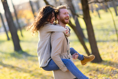 humor: Young couple having romantic date in park Stock Photo