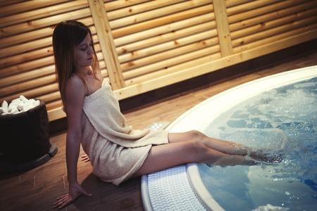 Woman enjoying jacuzzi in spa Stock Photo