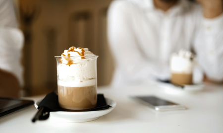 Coffee decorated with caramel syrup