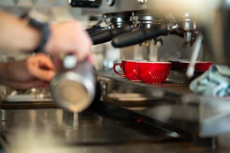 Barista making fresh coffee with machine