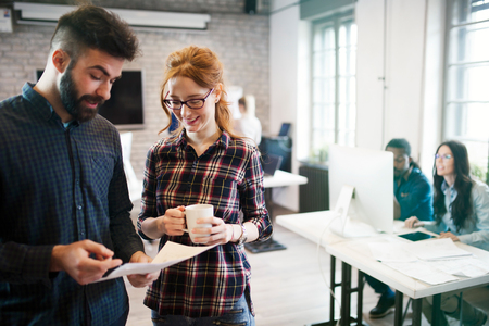 Picture of young designers discussing in office Stock Photo