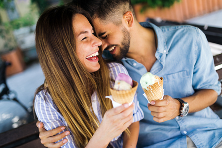 Happy couple having date and eating ice cream