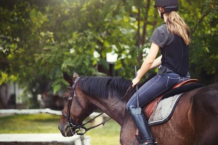 Portrait of young woman riding her horse Reklamní fotografie - 89179903