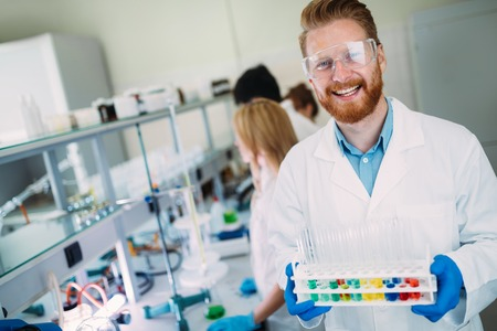 Portrait of young scientist posing in lab