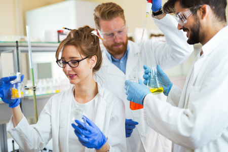 Group of chemistry students working in laboratory