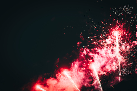 Picture of fireworks bursting on night sky Banco de Imagens