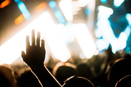 Cheering crowd with hands in air at music festival Stok Fotoğraf