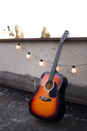 Picture of nice accoustic guitar on rooftop Reklamní fotografie