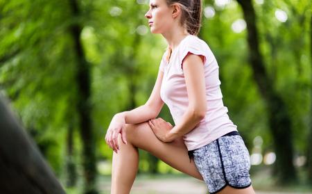 Tired female jogger Stock Photo