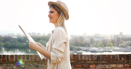Happy blond female traveling and sightseeing
