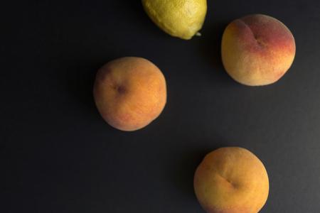 Fresh peaches and a lemon
