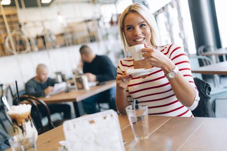 Beautiful woman enjoying beverages