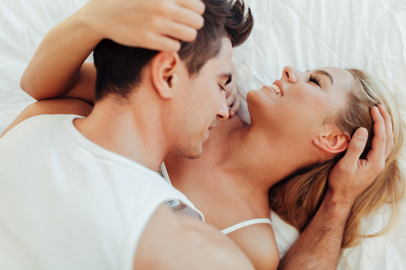 Sensual foreplay in bed Stock Photo