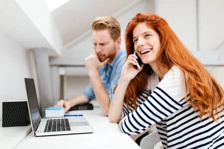 Woman calling partner from office