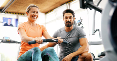 Personal trainer helping