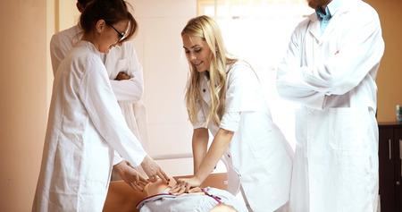 Group of medical students practicing reanimation task on model Reklamní fotografie