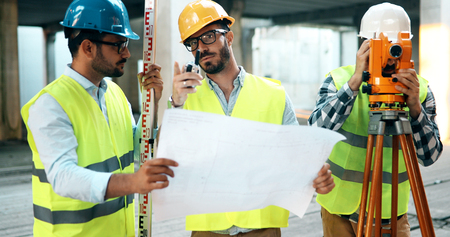 Group of engineering team had meeting at working site