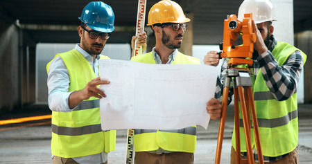 Team of architects people in group on construciton site