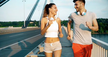 Couple jogging outdoors Stock Photo