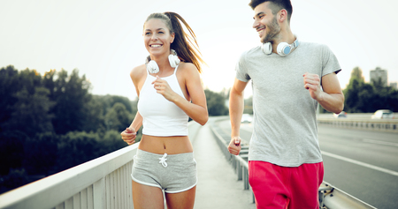 Attractive man and beautiful woman jogging together Stock Photo